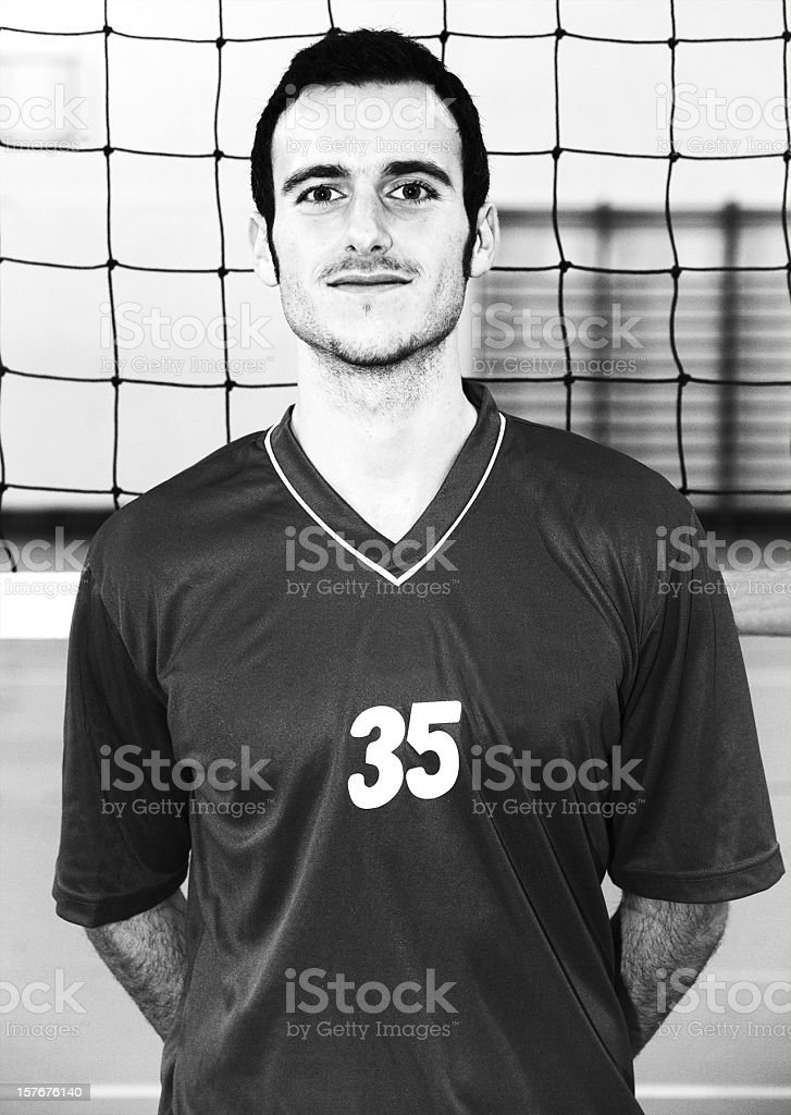 Young Volley player in front of the net Old Portrait royalty-free stock photo