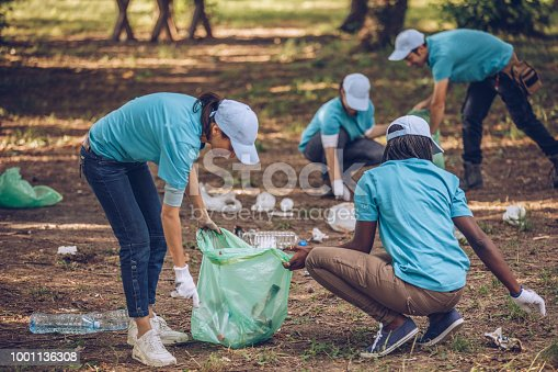 istock Young volunteers collecting garbage in nature 1001136308
