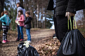 istock Young volunteers help collecting garbage in a public park 1210863873