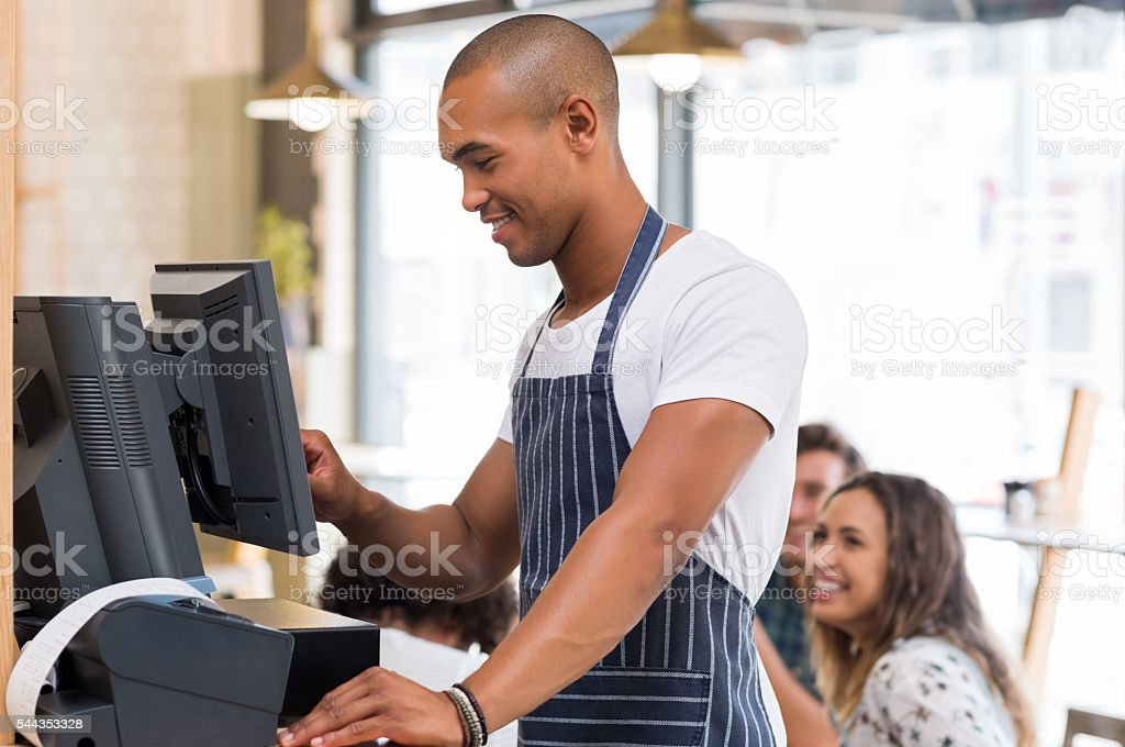 Young waiter doing bill stock photo