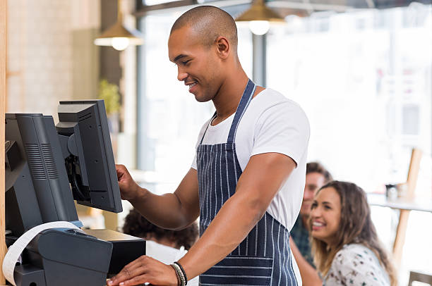 young waiter doing bill - receipt stock photos and pictures