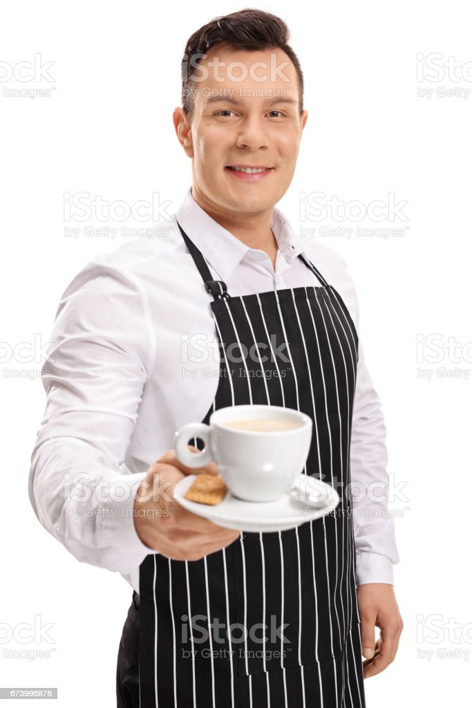 Young waiter offering a cup of coffee royalty-free stock photo