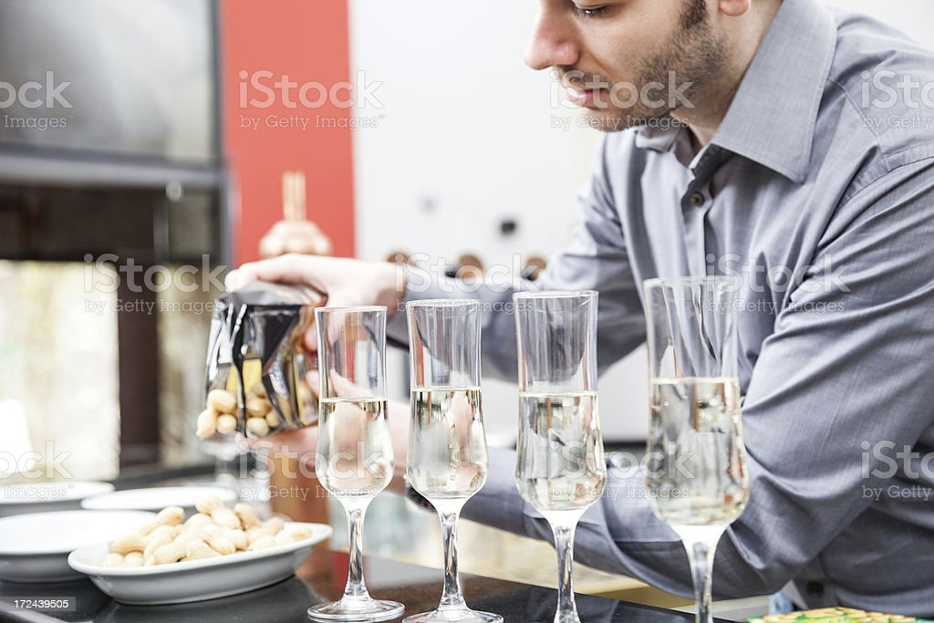 Young Waiter serve guests in a cafe stock photo