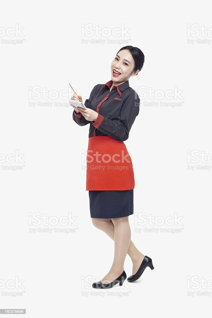 Young waitress taking an order, studio shot royalty-free stock photo