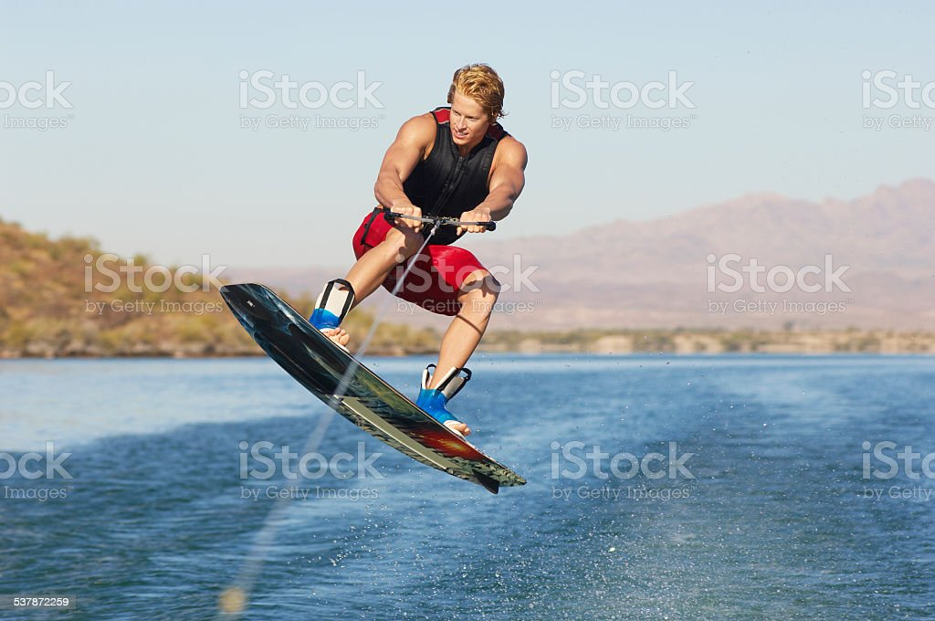 young wake boarder stock photo