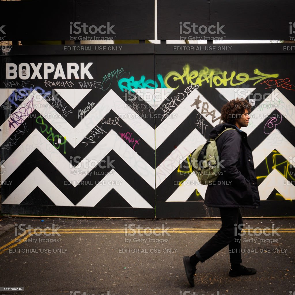 Young walking at the Boxpark in Shoreditch. stock photo