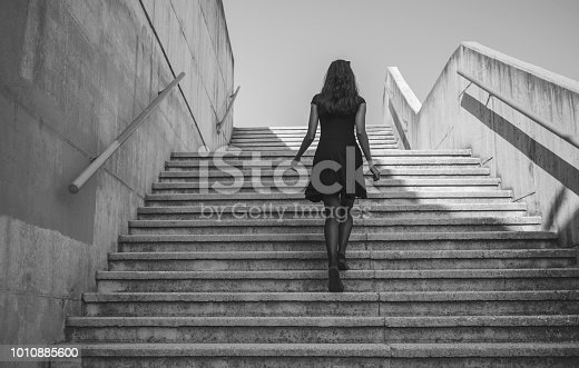 Young walking up the stairs.