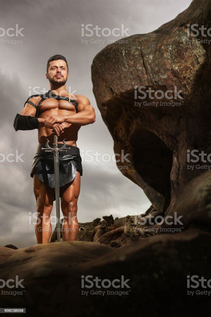 Young warrior on a mountain peak stock photo