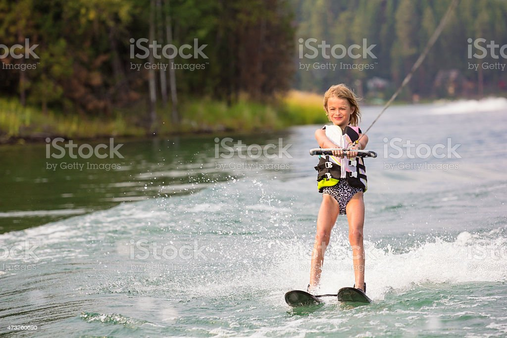Young Waterskier on a beautiful scenic lake stock photo