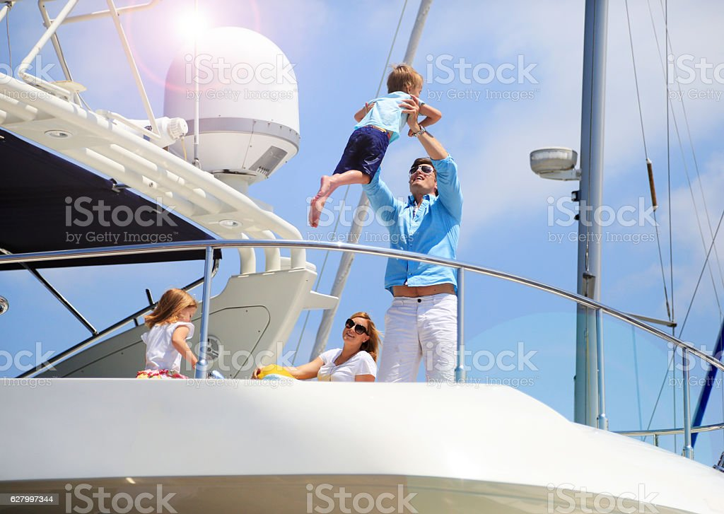 Young wealthy family enjoying summer vacation stock photo