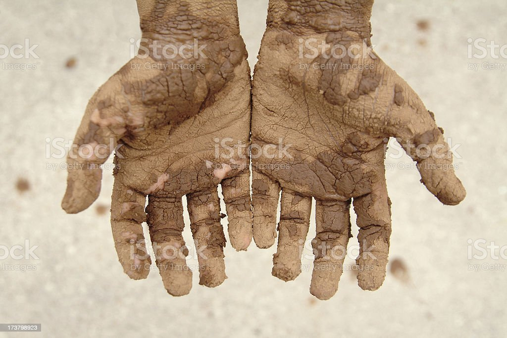 Young Weathered Outstretched Hands Covered in Mud royalty-free stock photo