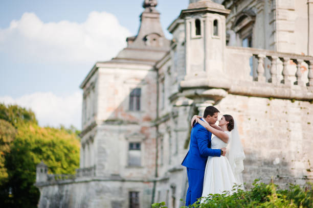 Young wedding couple on background old castle stock photo
