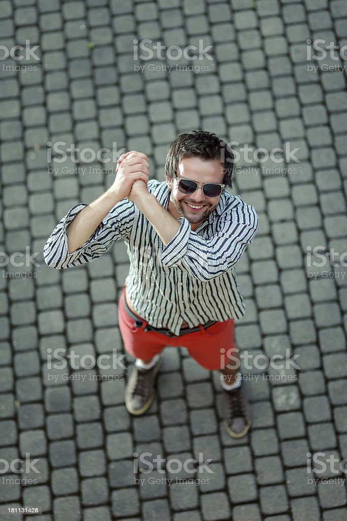 Young welcoming man royalty-free stock photo