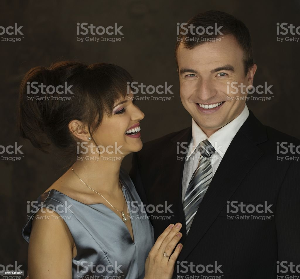 Young well-dressed smiling man and woman in evening dress royalty-free stock photo