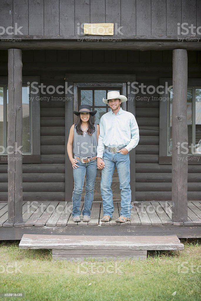 Young Western American Couple On Porch royalty-free stock photo