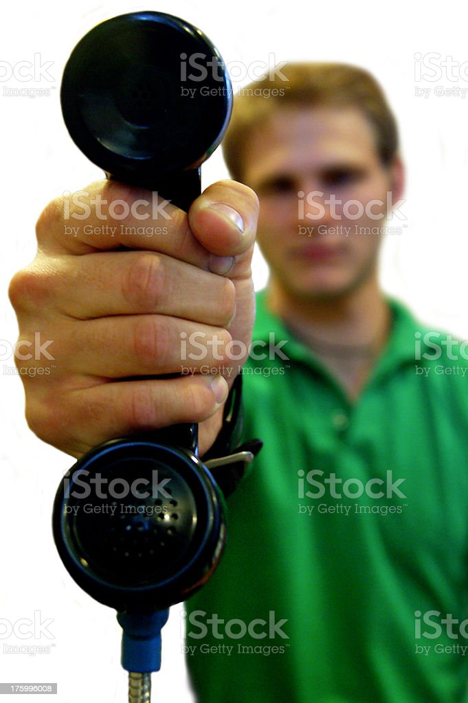 Young white adult holding phone towards viewer royalty-free stock photo