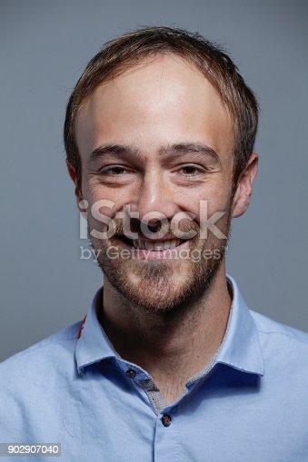 612752180istockphoto Young White man Portrait 902907040