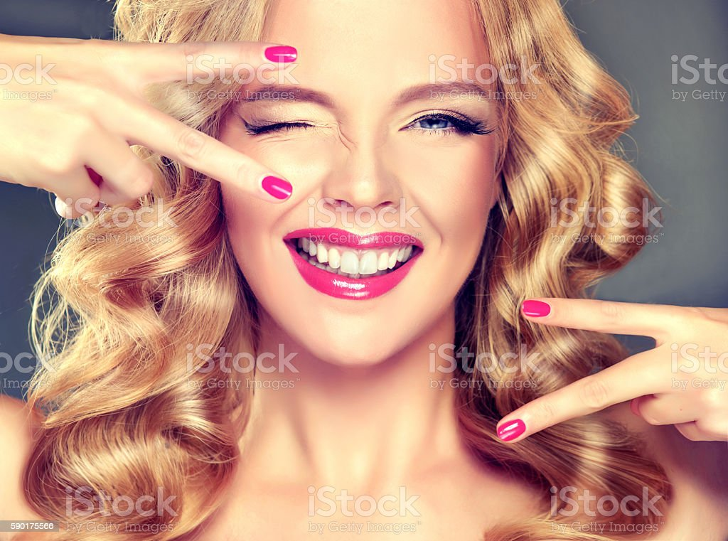 Young, wide smiling blonde model. stock photo