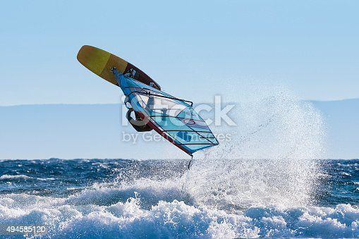 istock Young Windsurfer Jumping Wave on Windsurf Board 494585120