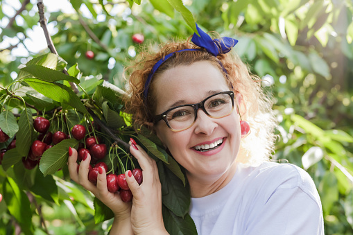 Young Woman 4045 Years With A Cherries Stock Photo - Download Image Now