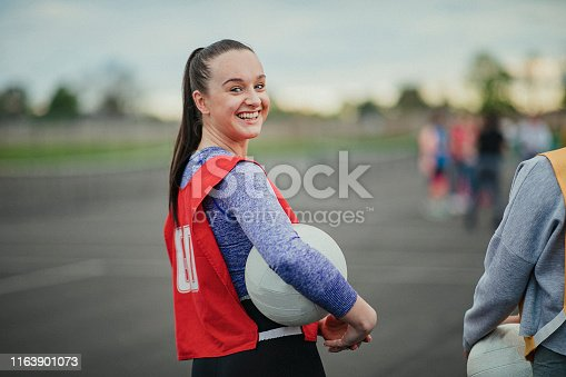 istock Young Woman About To Play Netball 1163901073