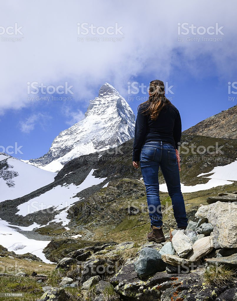 Young woman admiring the Matterhorn mountain royalty-free stock photo