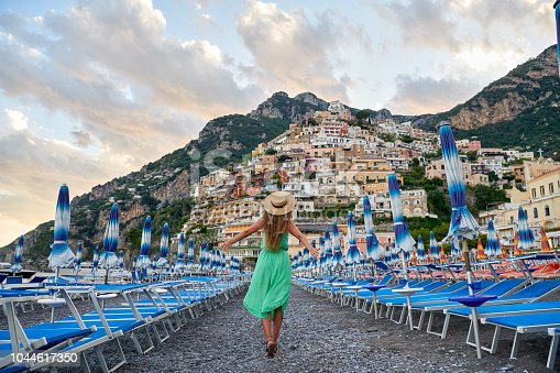 Italian vacations series. Young woman admiring the view of Positano village on Amalfi coast
