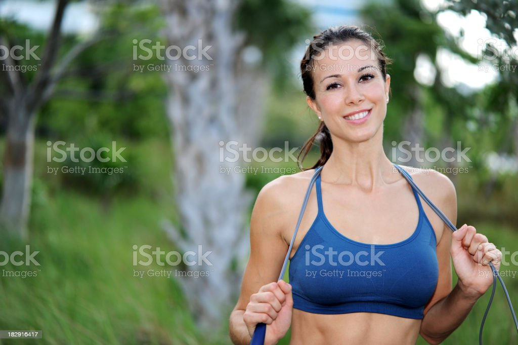 Young Woman Aerobics Instructor with Jumprope royalty-free stock photo