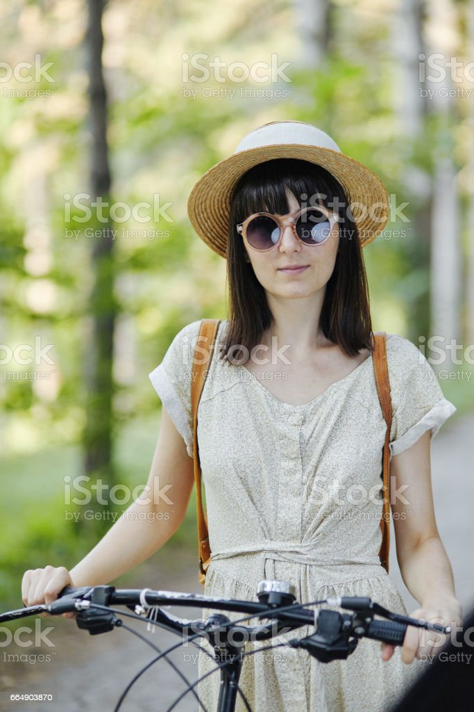 Young woman against nature background with bike foto stock royalty-free