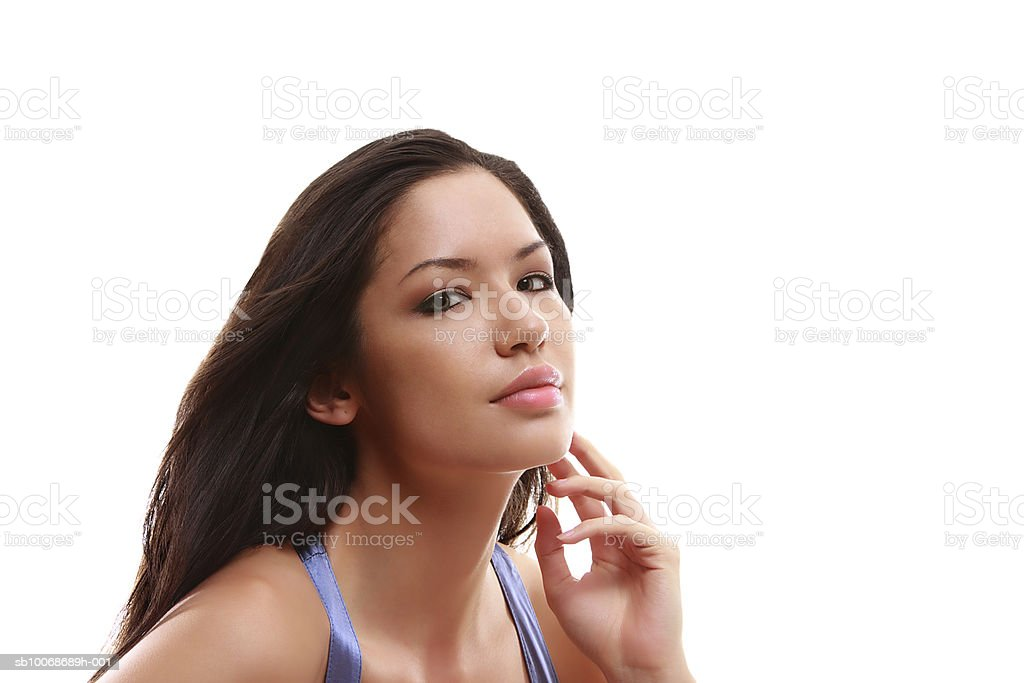 Young woman against white background, close-up, portrait royalty free stockfoto