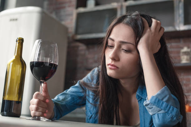 Young woman alcoholic social problems concept sitting with glass of picture id1146791000?b=1&k=6&m=1146791000&s=612x612&w=0&h=uo7r8g6ui 0s0zoy47hjz8 yjitcgaquvei2 igtumg=