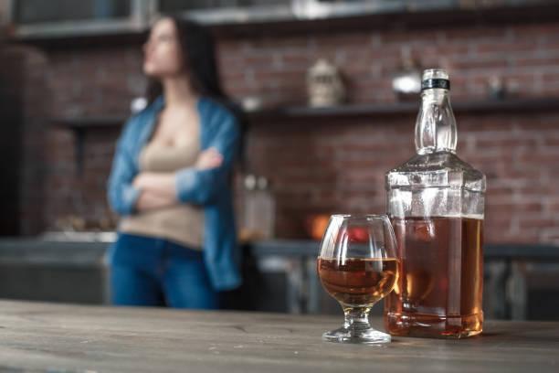 Young woman alcoholic social problems concept whiskey bottle closeup picture id1145351378?b=1&k=6&m=1145351378&s=612x612&w=0&h=9s63gwozr xbiglez7gfouwphlphjhxv1bz4n xx1uy=