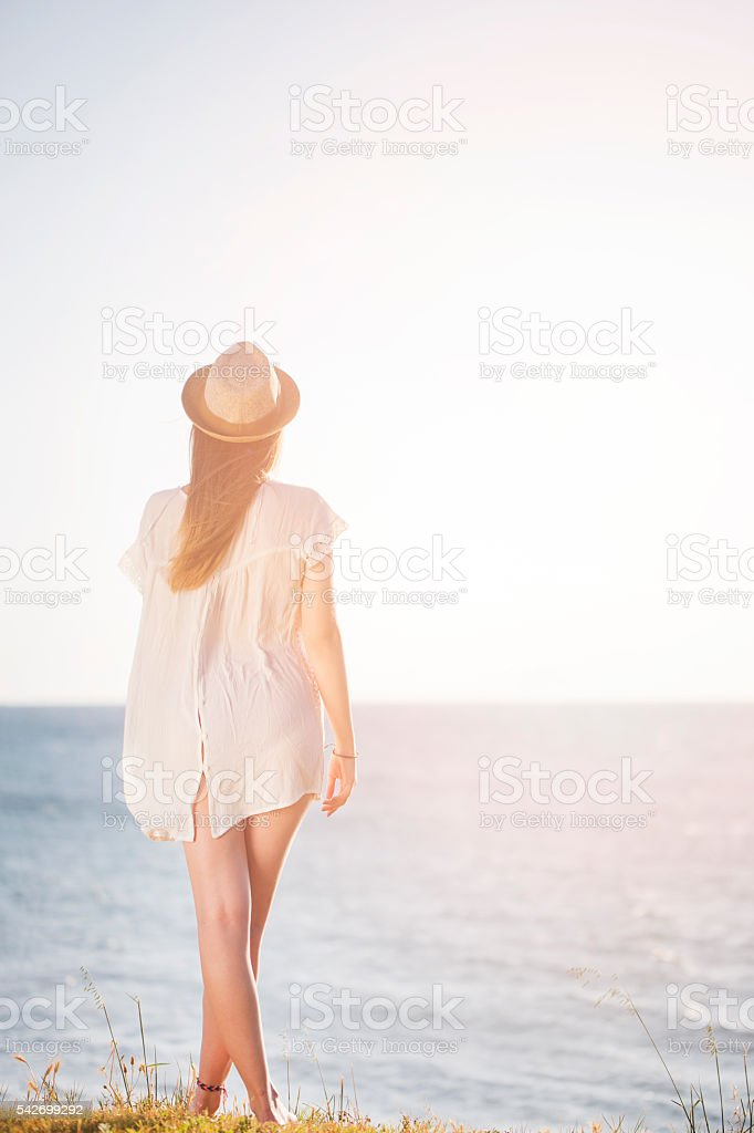 Young woman alone at the sunset stock photo