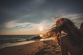 istock Young woman alone during sunset 1046246200