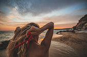 istock Young woman alone during sunset 1046252542
