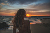 istock Young woman alone during sunset 1046252842