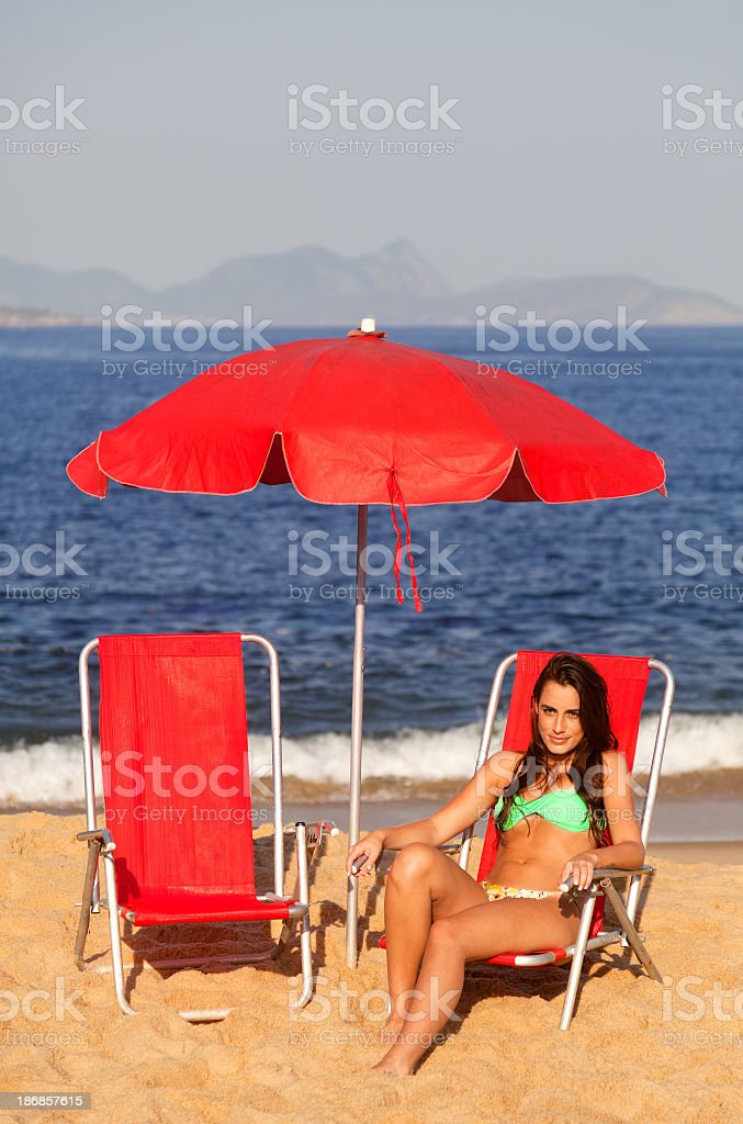 Young woman alone in the beach royalty-free stock photo
