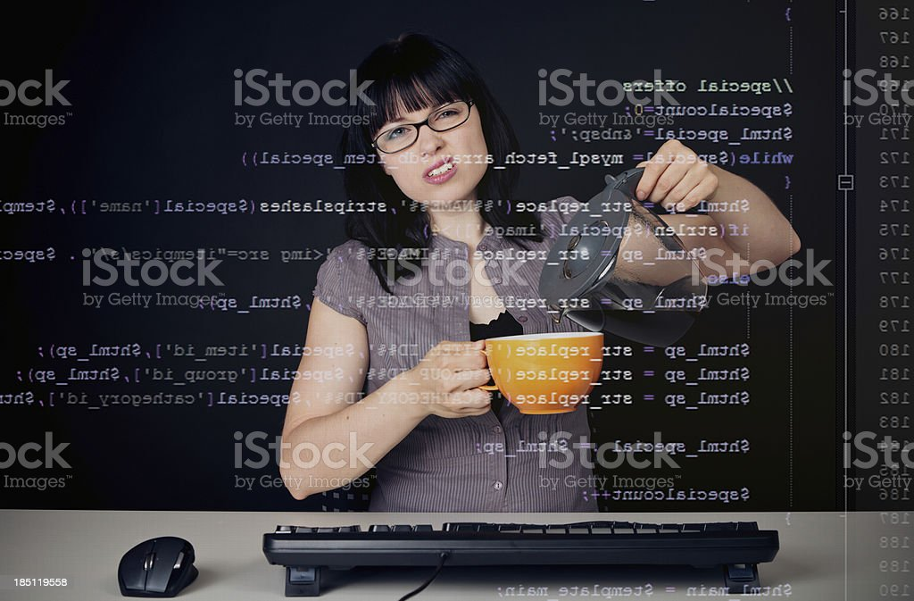 young woman analyzing php code royalty-free stock photo