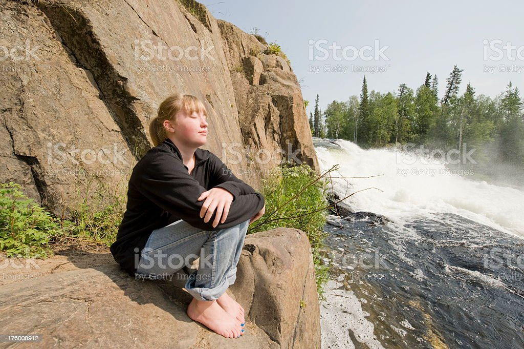 Young Woman and a Waterfall, Yellowknife. stock photo