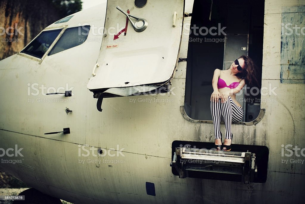 Young woman and broken plane royalty-free stock photo