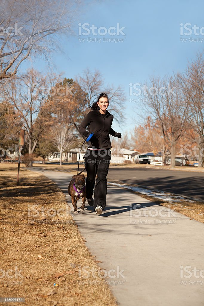Young Woman and Dog Jogging royalty-free stock photo
