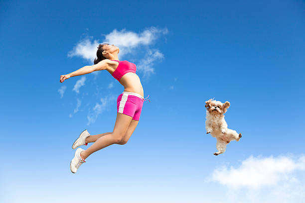 Young woman and dog jumping in the sky picture id483992655?b=1&k=6&m=483992655&s=612x612&w=0&h=mrjhgqu6eat9gsbzgjeouy25lzzmiuoq vkhfooonbm=