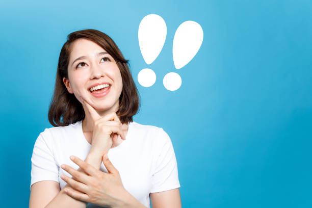 young woman and exclamation marks. stock photo