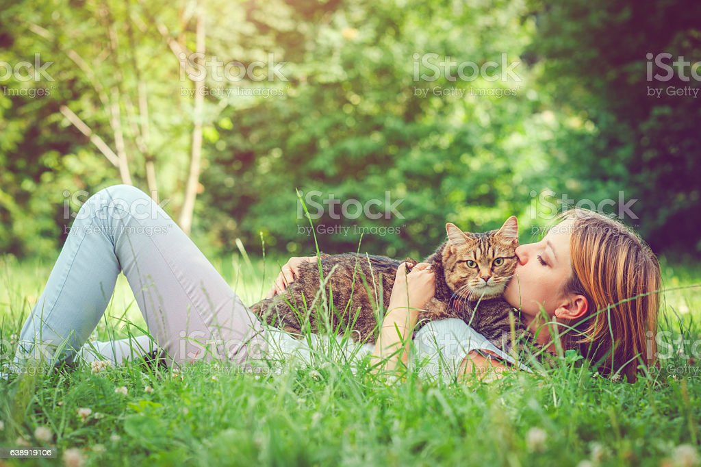 Young woman and her cat stock photo