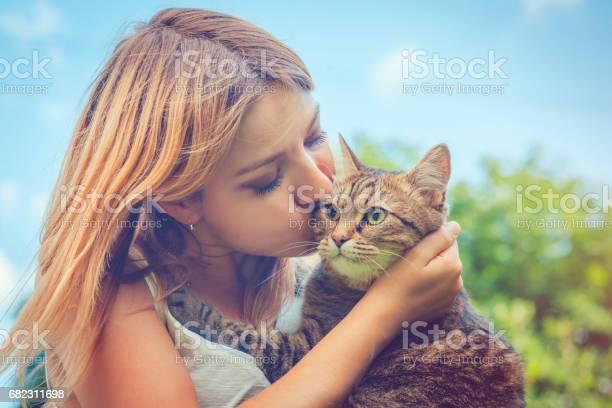 Young woman and her cat picture id682311698?b=1&k=6&m=682311698&s=612x612&h=52cavy8xle2etfnuttatayhl1rihhjmjxbmylt ro7y=