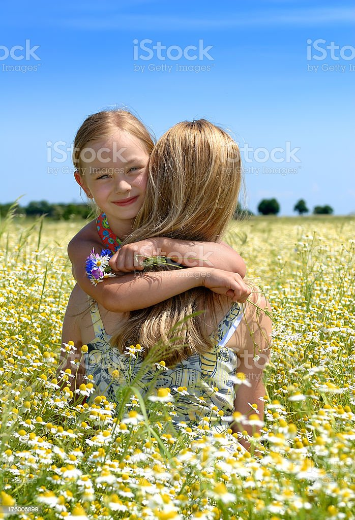 Young woman and her daughter royalty-free stock photo