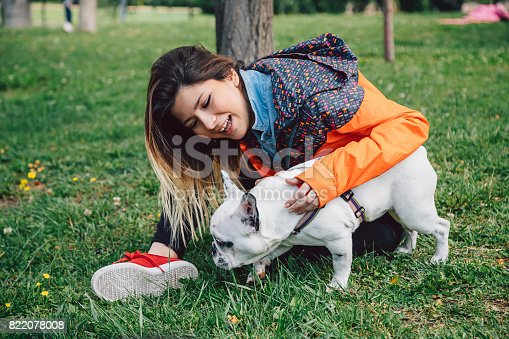 istock Young woman and her dog enjoying in the nature 822078008