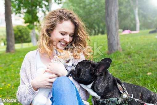 istock Young woman and her dog enjoying in the nature 929052614