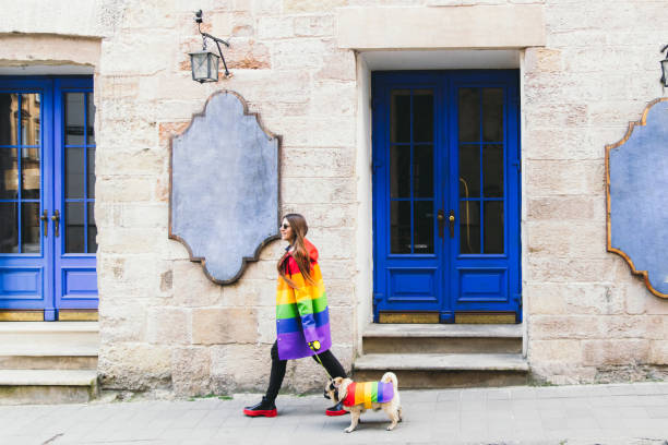 Young woman and her dog enjoying the great city walking in rainbow picture id1248970547?b=1&k=6&m=1248970547&s=612x612&w=0&h=hixg32 e3n9ozjs eprwzj0blbd0hiq1reupvaf7rwy=