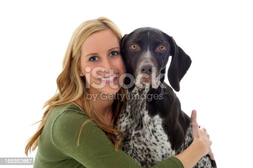 A smiling young woman in her mid-20s and her pet dog, a German Short-Haired Pointer. Isolated on white.